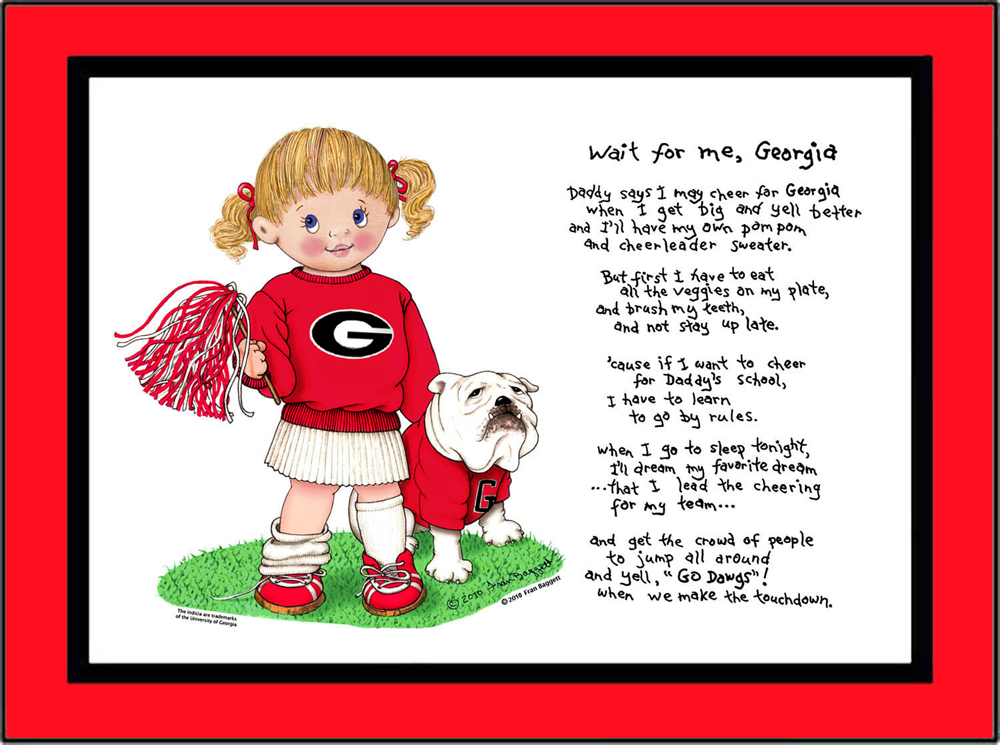 Georgia toddler cheerleader standing in the grass with her bulldog puppy beside her. She is wearing red bows in her hair, a Georgia sweatshirt, pleated skirt and sneakers with socks. She is holding a pom pom in one hand.